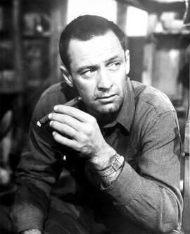 """Actor William Holden portrays the guarded, maverick hero in Billy Wilder's 1953 Paramount film, """"Stalag 17.""""  Holden won a best actor Academy Award for his role in a Nazi prisoner-of-war camp.  (AP Photo/Paramount Pictures)"""