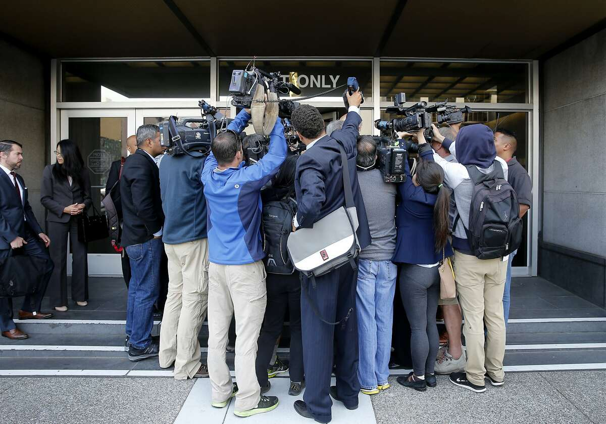 Members of the press gathered around attorney Jim Branahan in front of the Federal building in San Francisco, Calif. Former State Senator Leland Yee pleaded guilty Wednesday July 1, 2015 to charges of racketeering and admitting he accepted bribes.