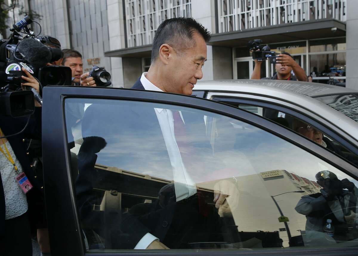 Leland Yee tried to avoid photographers as he left the Federal building in San Francisco, Calif. Former State Senator Leland Yee pleaded guilty Wednesday July 1, 2015 to charges of racketeering and admitting he accepted bribes.