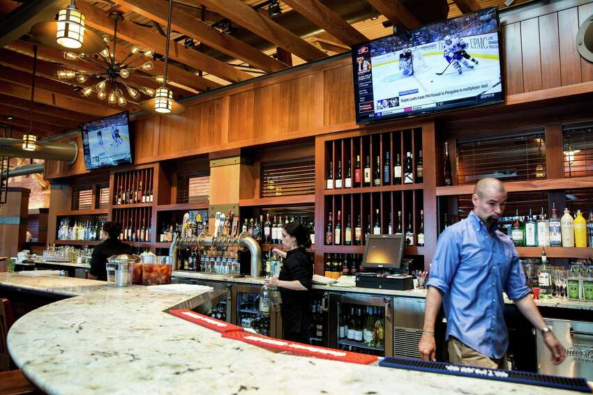 Interior views of the revamped Seattle waterfront restaurant, Ivar's Acres of Clams and Fish Bar, as it reopened its doors Wednesday, July 1, 2015, in Seattle, Washington. The 20 million dollar transformation includes an overhauled interior, state-of-the-art kitchen, additional seating and an outdoor patio offering views of the Puget Sound and Olympic Mountains.