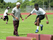 Earl Thomas coaches athletes during his camp at West Orange-Stark on Friday.  Photo taken Friday, June 26, 2015  Guiseppe Barranco/The Enterprise