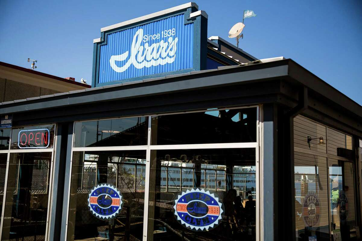 Fresh, new signage on Seattle's waterfront restaurant, Ivar?•s Acres of Clams and Fish Bar. Park free at four Seattle waterfront garages on Mother's Day, and partake of Seattle's seafood history..