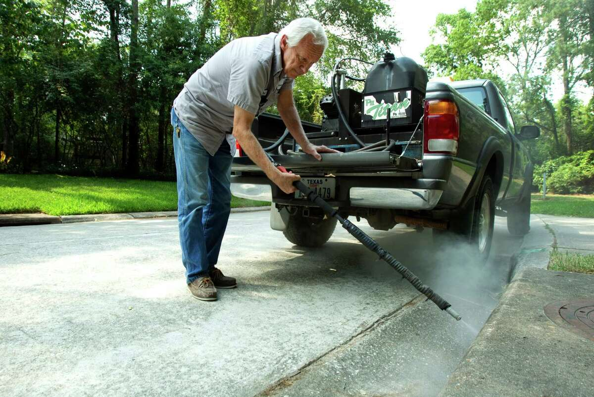 Paul Culbertson, of Montgomery County Pct. 3 Mosquito Abatement, sprays a storm drain to fight mosquitos Wednesday, June 6, 2012, in The Woodlands. Recent testing in South Montgomery County revealed the presence of West Nile virus. ( Brett Coomer / Houston Chronicle )