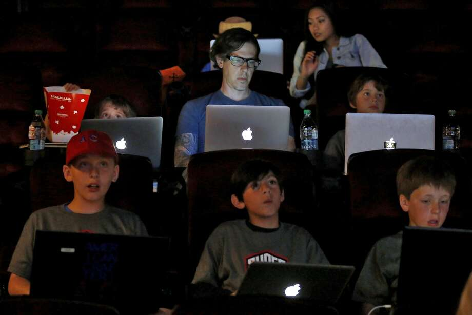 Chris Henley, 40, was one of more than 50 children and parents who took part in a game of Minecraft in a movie theater in Redwood City, California, on Tuesday, June 23, 2015. The event was put on by Super League Gaming as a demo of a league they want to launch in September. Photo: Connor Radnovich, The Chronicle
