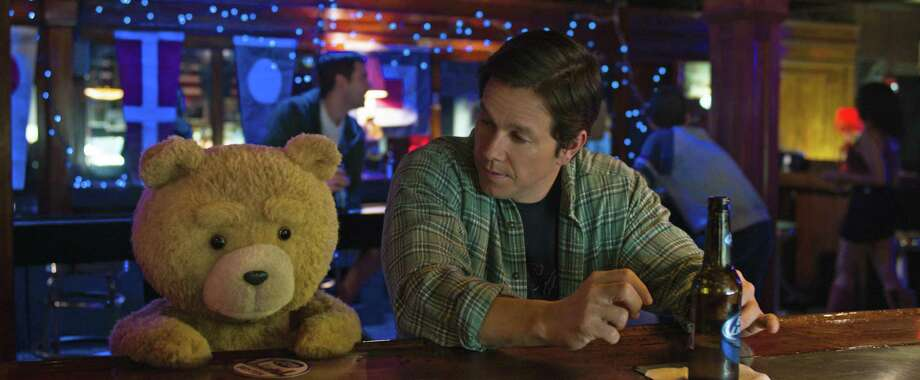 """Ted 2,"" starring Mark Wahlberg, right, and the voice of Seth MacFarlane as Ted, couldn't knock off the top two films at the box office in its opening week. Photo: HONS / Universal Pictures"