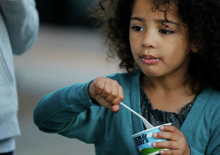 Chloe Shakur eats her ice cream outside of a Ben & Jerry's ice cream shop. Photo: Leah Millis, Staff / ONLINE_YES