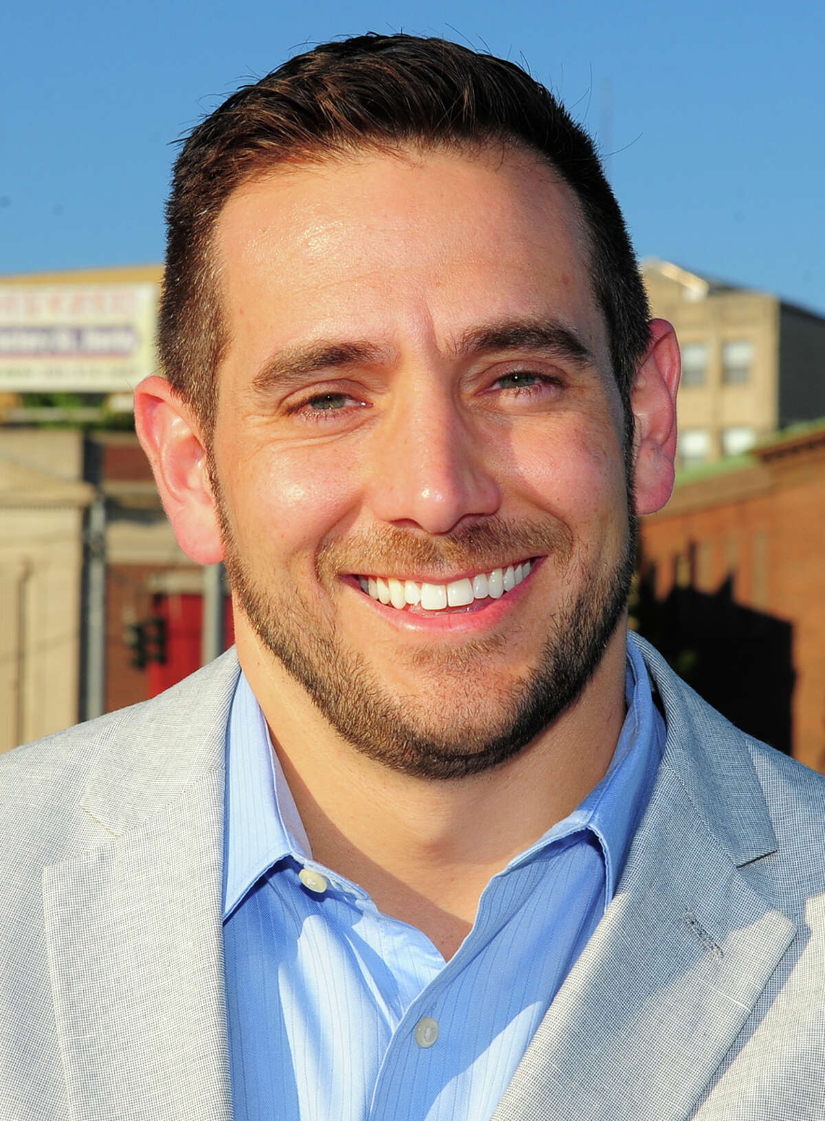 Derby native J.R. Romano, the newly elected state GOP chairman, with Derby in the background on Wednesday.