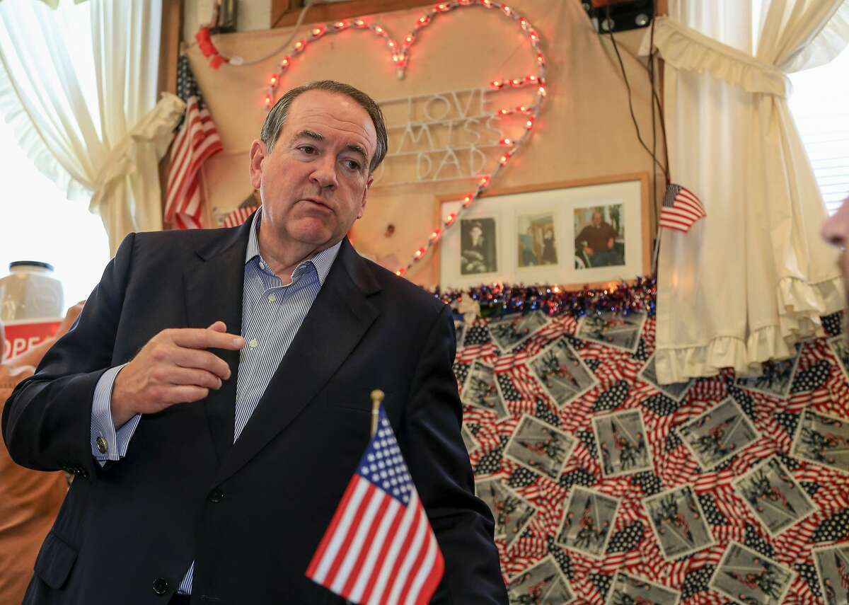 Republican presidential candidate, former Arkansas Gov. Mike Huckabee, speaks to a supporter during a town hall event at the Main Street Cafe in Council Bluffs, Iowa, Wednesday, July 1, 2015. (AP Photo/Nati Harnik)