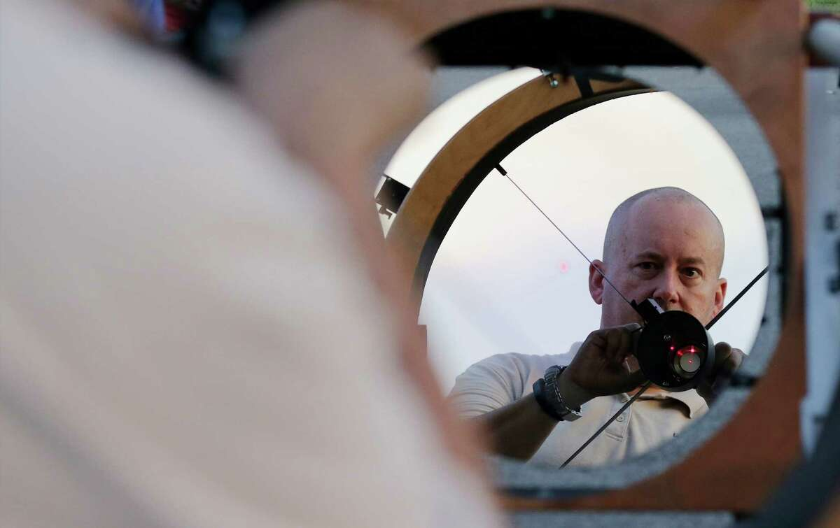 Astronomer Bryan Tobias aligns his Newtonian reflector 30
