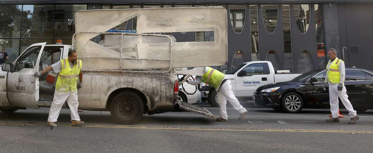San Francisco Municipal Transportation agency employees prepare to paint arrows and a no turn sign on 6th at Stevenson streets in San Francisco, Calif., on Wednesday, July 1, 2015. City project Safer Market Street will deter most private vehicle traffic off of Market Street.
