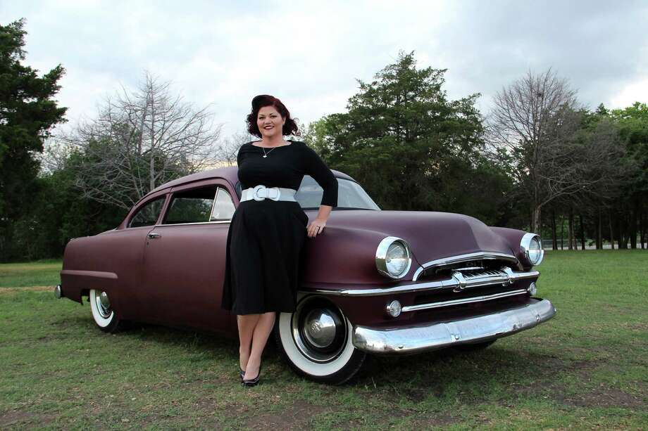 Christina McCanlies poses with her 1954 Plymouth. Photo: Heidi Van Horne