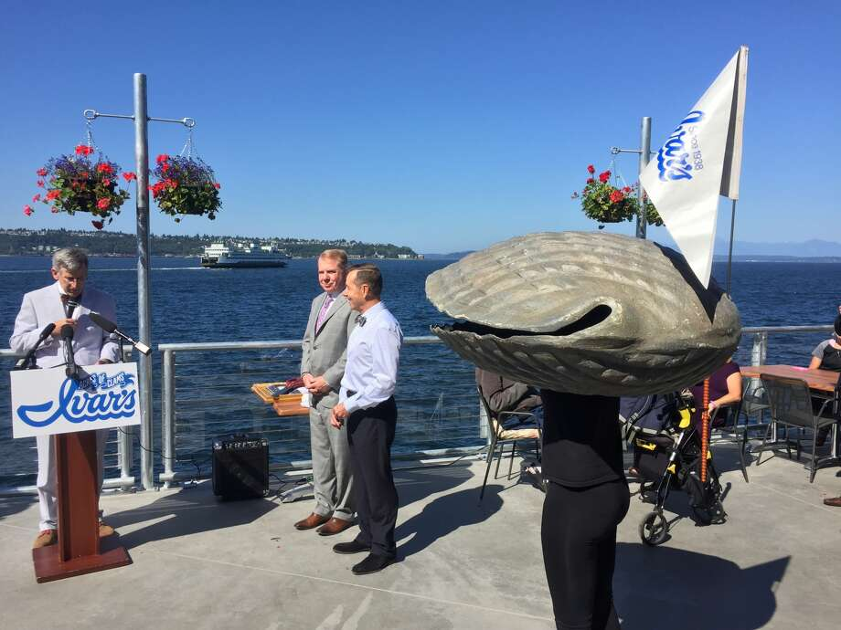 Bob Donegan, Ivar's president, re-opens the original restaurant and Pier 54 at a news conference in Seattle on Wednesday, July 1, 2015. He was joined by Seattle Mayor Ed Murray and Seattle City Council member Tom Rasmussen ... and the Ivar's clam! Photo by JAKE ELLISON/SEATTLEPI.COM