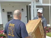 Frankie Delgado, right, moves his family into an apartment in the Laurel Hill complex, in Brookfield, Conn, on Wednesday July 1, 2015. A friend Malik Shetab, of Danbury, was on hand to help with the move. Delgato and his wife Candice Lovato and their daughter Maya Delgado will live in the new apartment complex just south of the Four Corners in Brookfield.
