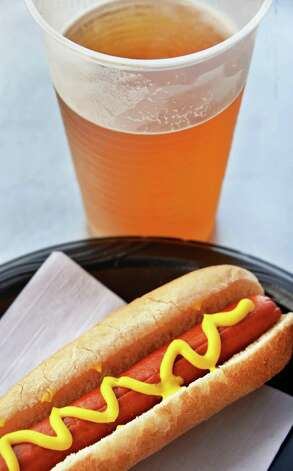 A Helmbold hot dog in a Mastroianni roll and a Brown's cream ale at Joe Bruno Stadium Wednesday June 24, 2015 in Troy, NY.   (John Carl D'Annibale / Times Union) Photo: John Carl D'Annibale / 00032376A