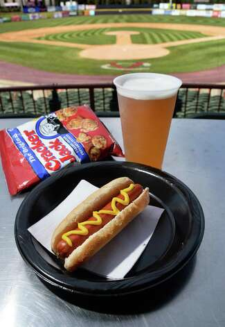 A Helmbold hot dog in a Mastroianni roll, a Brown's cream ale and Cracker Jacks at Joe Bruno Stadium Wednesday June 24, 2015 in Troy, NY.   (John Carl D'Annibale / Times Union) Photo: John Carl D'Annibale / 00032376A