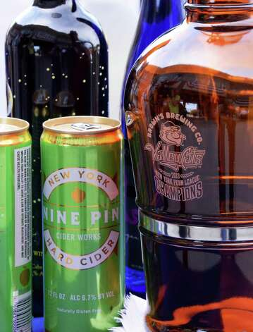 Nine pin cider and a Brown's beer growler at Joe Bruno Stadium Wednesday June 24, 2015 in Troy, NY.   (John Carl D'Annibale / Times Union) Photo: John Carl D'Annibale / 00032376A