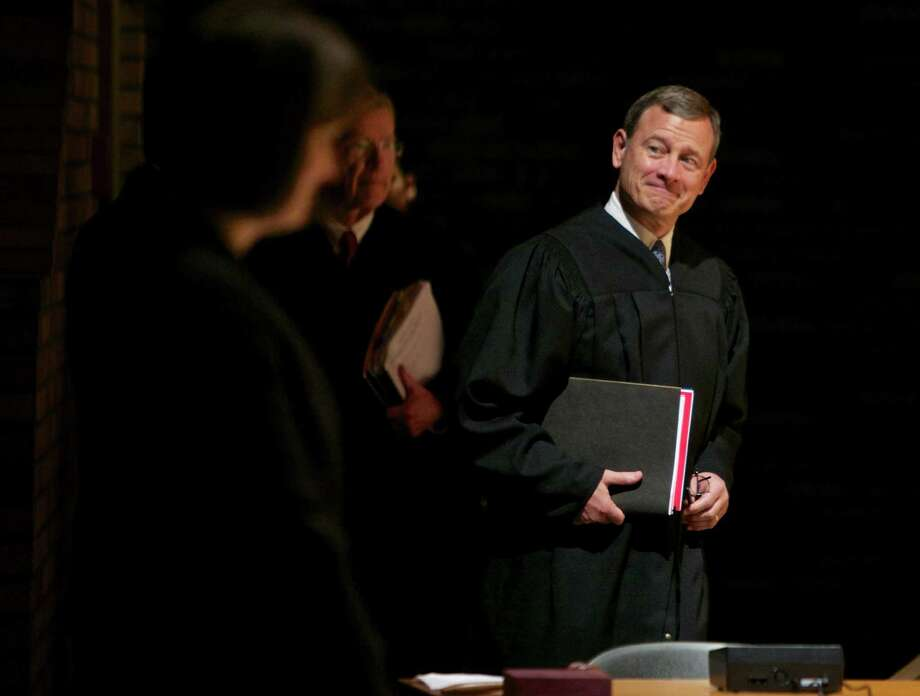 Did Chief Justice John Roberts (right), play a political hand in the Obamacare ruling to protect the U.S. Supreme Court from the outrage that would have followed if millions of Americans lost their health insurance? Photo: Thomas Boyd /Associated Press / The Oregonian