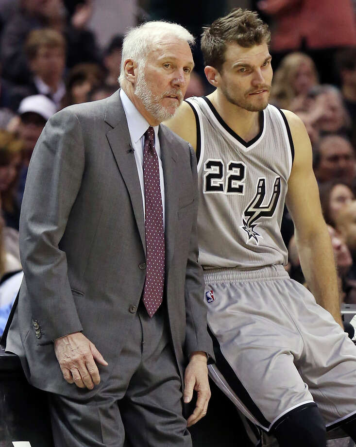 San Antonio Spurs head coach Gregg Popovich (left) talks with Tiago Splitter during first half action against the Los Angeles Clippers Saturday Jan. 31, 2015 at the AT&T Center. Photo: Edward A. Ornelas, Staff / San Antonio Express-News / © 2015 San Antonio Express-News