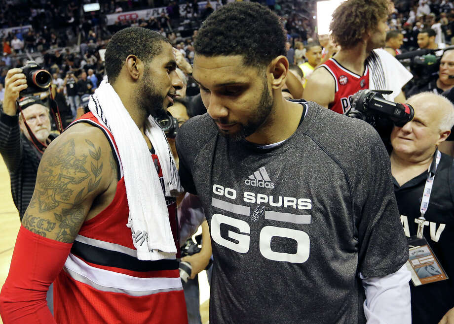 Portland Trail Blazers' LaMarcus Aldridge and San Antonio Spurs' Tim Duncan talk after Game 5 in the Western Conference semifinals Wednesday May 14, 2014 at the AT&T Center. The Spurs won 104-82. The Spurs advance to the Western Conference finals. Photo: Edward A. Ornelas /San Antonio Express-News / © 2014 San Antonio Express-News