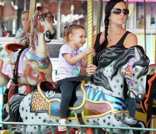 Three-year-old Gabriella Merriman rides the Merry Go Round with her mother Nicole Merriman of Rotterdam at the Grand opening of Huck Finn's Playland Wednesday July 1, 2015, Albany, NY.  (John Carl D'Annibale / Times Union) Photo: John Carl D'Annibale / 00032437A