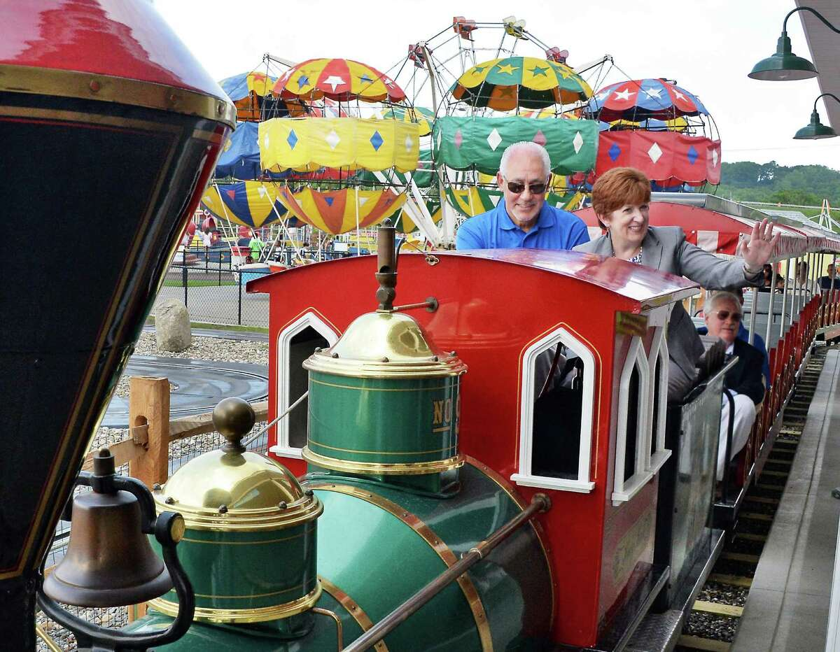 CEO Jeff Sperbers, left, and Mayor Kathy Sheehan ride the Playland train during the Grand opening of Huck Finn's Playland Wednesday July 1, 2015, Albany, NY. (John Carl D'Annibale / Times Union)