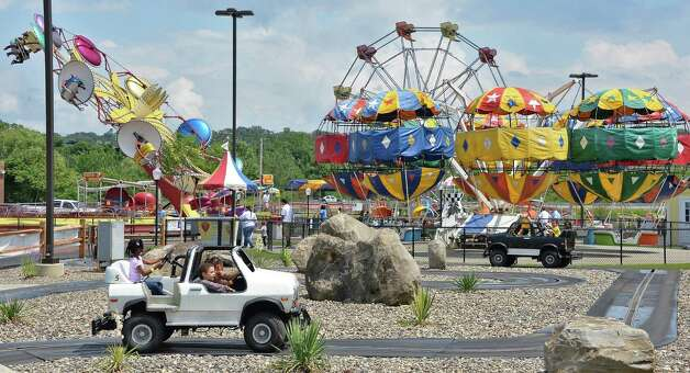 Children on the rides at the Grand opening of Huck Finn's Playland Wednesday July 1, 2015, Albany, NY.  (John Carl D'Annibale / Times Union) Photo: John Carl D'Annibale / 00032437A