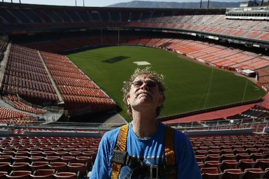 Steeplejack Jim Phelan contemplates flagpole at Candlestick Park.