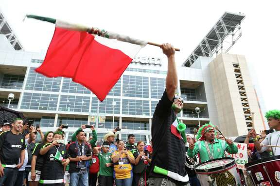 David Ortiz dances with Isabel Campuzano before the Mexico - Honduras game at NRG Stadium Wednesday, July 1, 2015, in Houston.
