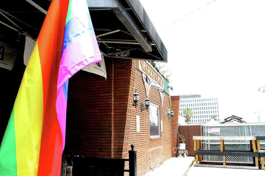 A rainbow flag hangs outside Sparky's Pub June 29, three days after the Supreme Court's historic decision to make same-sex marriage legal in all 50 states. Photo: Kelsey Bradshaw /San Antonio Express-News