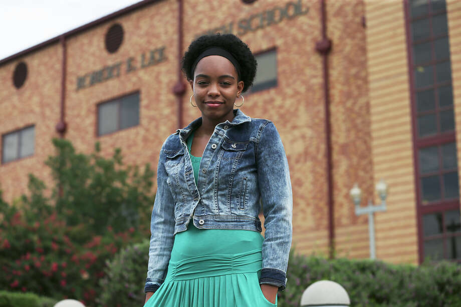 Robert E. Lee High School student Kayla Wilson stands in front of her school. She started a petition last summer to rename the school. Photo: Tom Reel /San Antonio Express-News / San Antonio Express-News