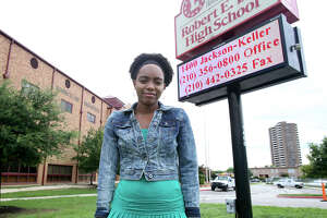 Robert E. Lee High School student Kayla Wilson stands in front of the campus. An online petition to change its name that she created had 11,000 signatures as of Tuesday.