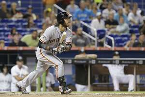 Giants lose at Miami on Justin Bour's 3-run HR in 9th - Photo