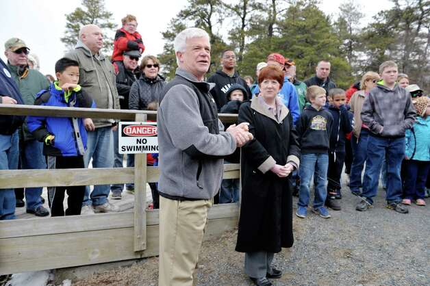 DEC Commissioner Joe Martens, left, and Albany Mayor kathy Sheehan address those gathered during a free fishing event at Rensselaer Lake on Monday, April 6, 2015, in Albany, N.Y.  (Paul Buckowski / Times Union archive) Photo: PAUL BUCKOWSKI / 00031311A