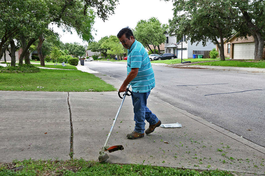 Miguel Ramos works on his yard in the 5600 block of Timber Bark on the Northwest Side. The permit doesn't necessarily mean his neighborhood will be first in line for Google Fiber. Photo: Jerry Lara /San Antonio Express-News / © 2015 San Antonio Express-News