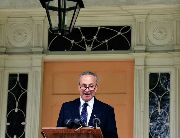 Senator Chuck Schumer speaks on the steps of the Thomas Cole House Wednesday morning July 1, 2015,   in Catskill, N.Y. Sen.Schumer will use the discovery of two decorative friezes painted by Hudson River landscape painter Thomas Cole to urge the National Endowment for the Humanities to provide funds for late artist's home on Spring Street. The murals were uncovered recently in two of the rooms at Cole's home. Cole painted the friezes in 1836. Authorities said they were covered by common wall paint around 1900. (Skip Dickstein/Times Union) Photo: SKIP DICKSTEIN / 00032462A
