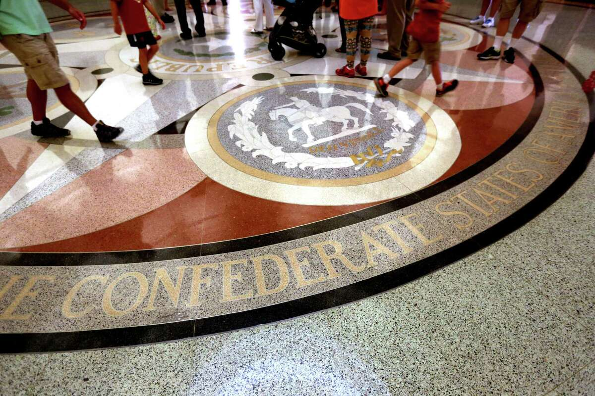 Six flags over Texas The floor of the Capitol Rotunda  shows the names and emblems of the