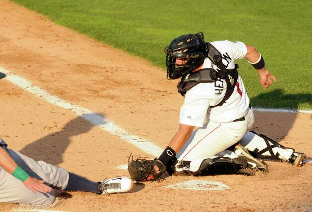 Cat's catcher Anthony Hermelyn gets the out at home plate during the Tri-City ValleyCats game against the Vermont Lake Monsters at Joe Bruno Stadium on Wednesday July 1, 2015 in Troy, N.Y.  (Michael P. Farrell/Times Union) Photo: Michael P. Farrell / 00032413A
