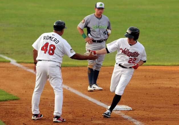 Cat's Drew Ferguson is greeted by manager Ed Romero as he rounds third after hitting a home run during the Tri-City ValleyCats game against the Vermont Lake Monsters at Joe Bruno Stadium on Wednesday July 1, 2015 in Troy, N.Y.  (Michael P. Farrell/Times Union) Photo: Michael P. Farrell / 00032413A