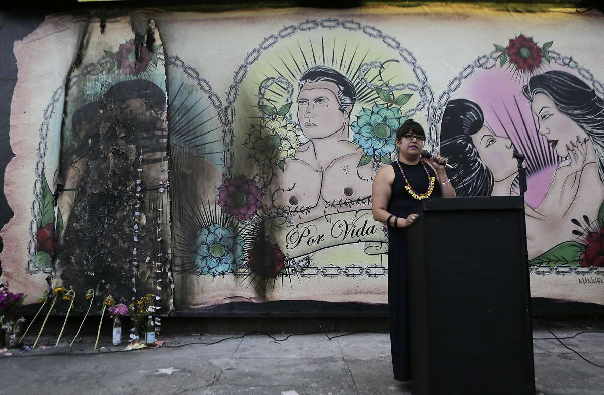 Director of Galeria de la Raza, Ani Rivera speaks to the crowd during a rally on Wednesday, July 1, 2015 at the mural in the Mission District in San Francisco, Ca.. The mural at the Galeria de la Raza is in celebration of the LGBT and Latino culture in the Mission District.