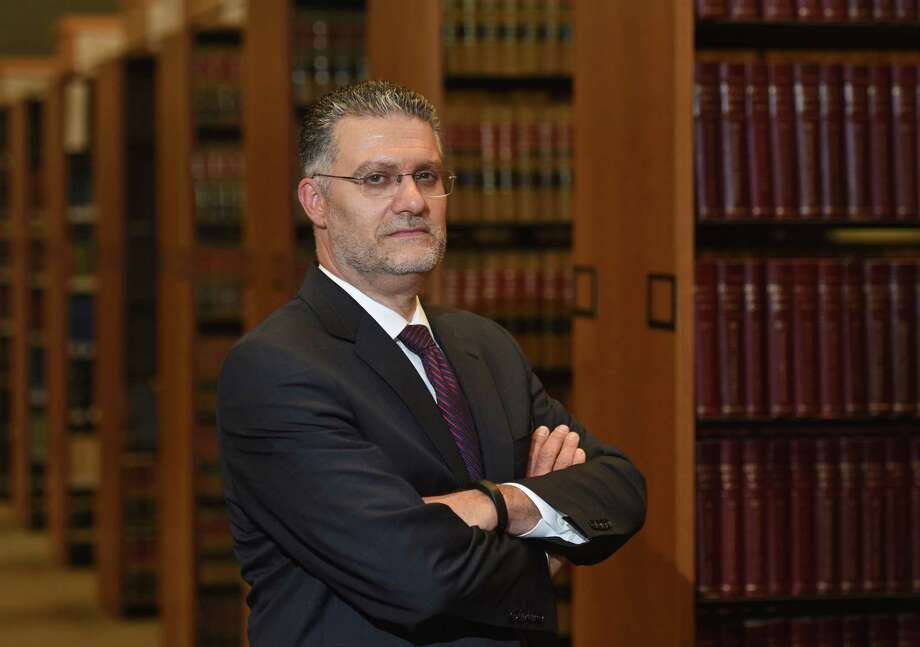 Richard Colangelo poses at state Superior Court in Stamford on Wednesday. Colangelo was appointed to the State's Attorney for the Stamford-Norwalk Judicial District, making him the top officer of the law in a region that includes Greenwich, Stamford, Darien, New Canaan, Norwalk, Westport, Weston and Wilton. Photo: Tyler Sizemore / Hearst Connecticut Media / Greenwich Time