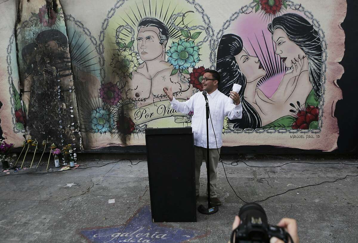 District Supervisor David Campos speaks to the crowd during a rally on Wednesday, July 1, 2015 at the mural in the Mission District in San Francisco, Ca.. The mural at the Galeria de la Raza is in celebration of the LGBT and Latino culture in the Mission District.