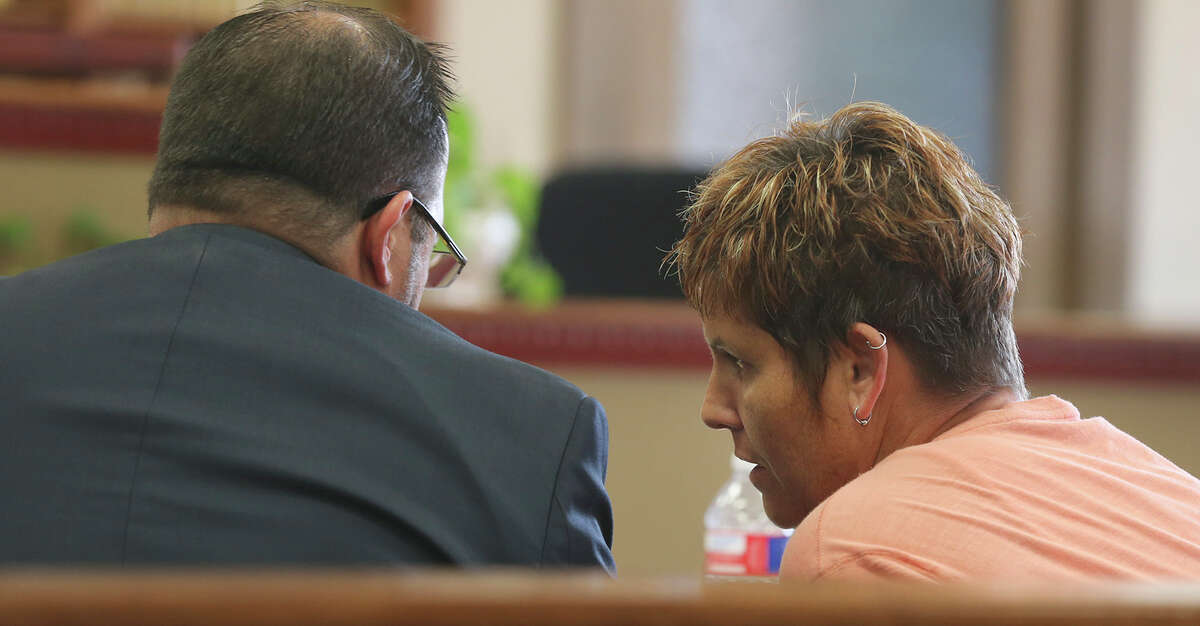 Kristi Lesh speaks with her attorney during the same-sex custody case at the 150th District Court.