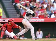 ANAHEIM, CA - JULY 01:  Didi Gregorius #18 of the New York Yankees hits an RBI single in the eighth inning against the Los Angeles Angels of Anaheim at Angel Stadium of Anaheim on July 1, 2015 in Anaheim, California.  (Photo by Stephen Dunn/Getty Images) ORG XMIT: 538585447