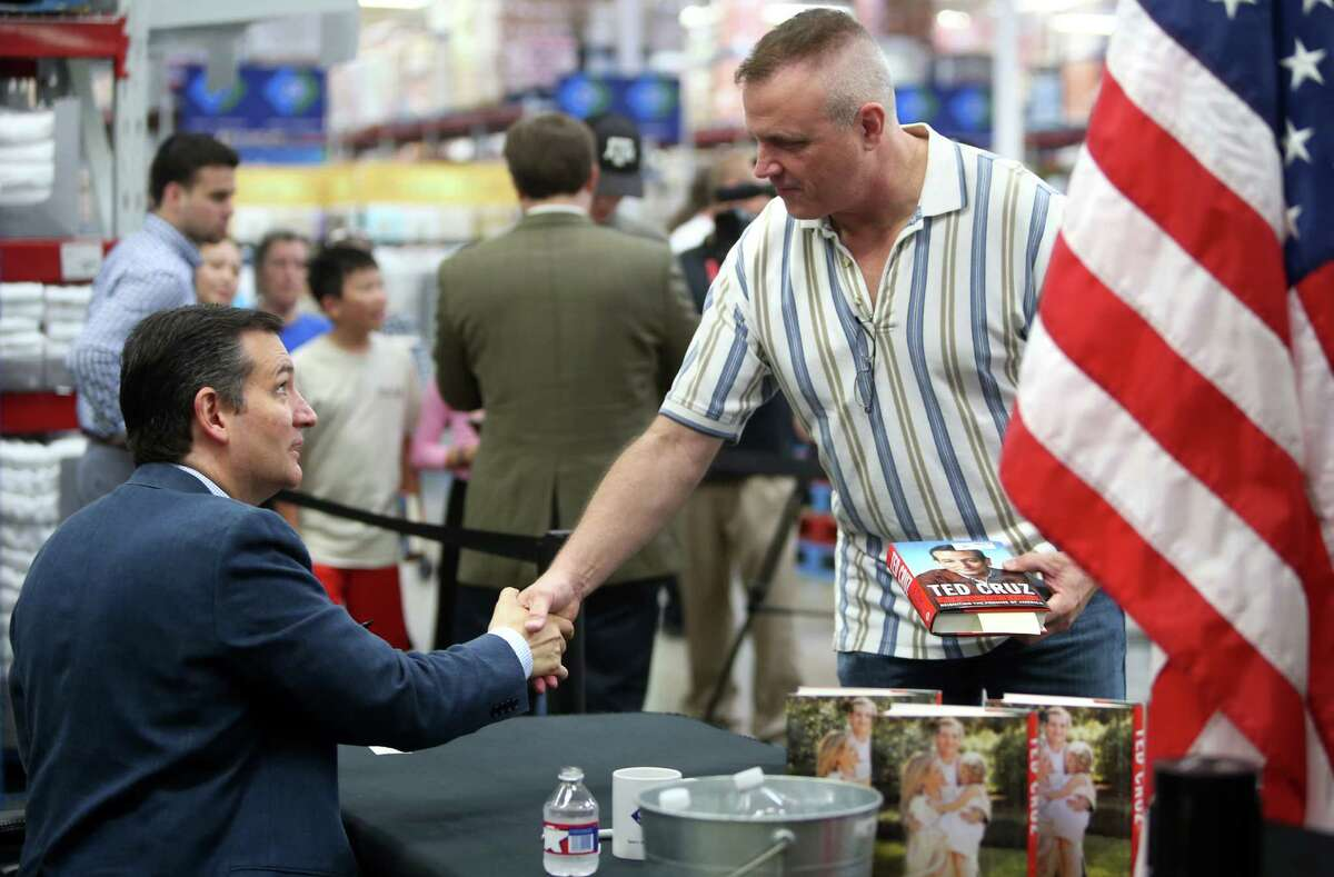 """Tom Adkins shakes hands with Sen. Ted Cruz during a book signing event at Sam's Club on Wednesday, July 1, 2015, in Houston. The new book """"A Time For Truth"""" is released today."""