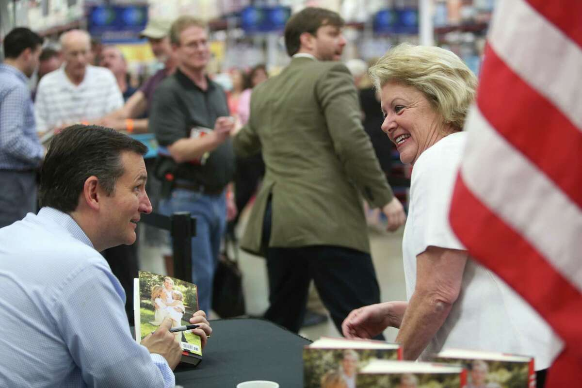 """Sen. Ted Cruz talks about his daughters to Karen Packard while signing his new book """"A Time For Truth"""" at Sam's Club on Wednesday, July 1, 2015, in Houston."""