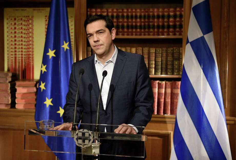 Greek Prime Minister Alexis Tsirpas delivers a televised address to the nation from his office at Maximos Mansion on Wednesday. Photo: Greek Prime Minister's Office /Getty Images / 2015 Greek Prime Minister's Office