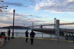 Woman killed in shooting on Pier 14 - Photo