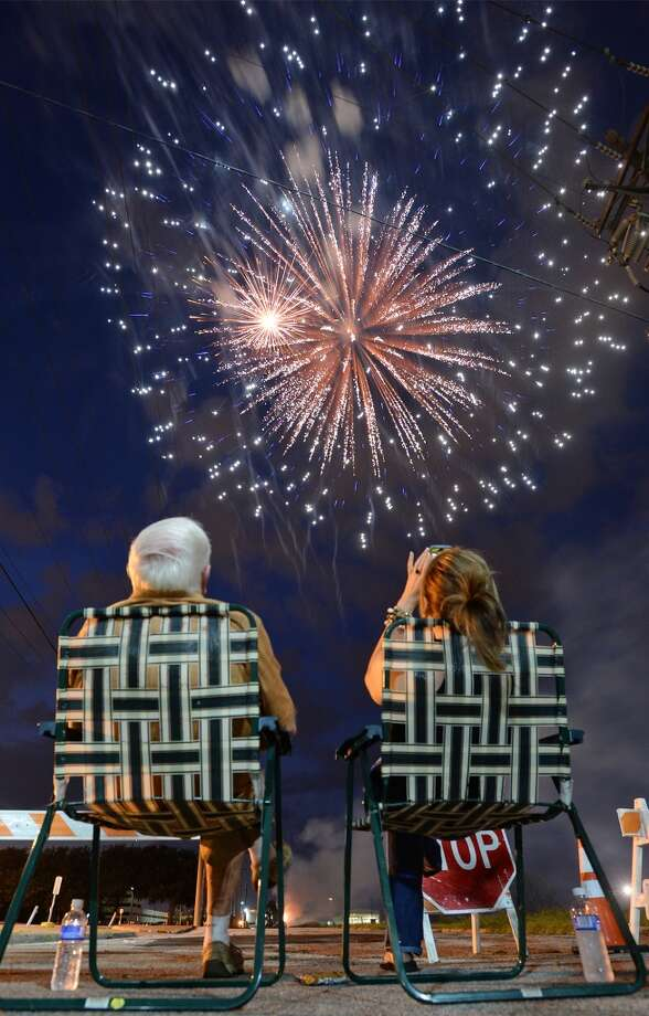Firework fans flocked Friday to downtown Beaumont in celebration of Independence Day. Along with fireworks guest were treated to food vendors, music and other entertainment.  Photo taken Friday, July 04, 2014 Guiseppe Barranco/@spotnewsshooter
