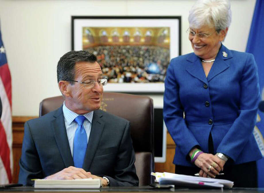 Gov. Dannel P. Malloy, left, shares a light moment Lt. Gov. Nancy Wyman before signing the new state budget in his office Tuesday at the State Capitol in Hartford. Photo: Jessica Hill / Associated Press / Fairfield Citizen