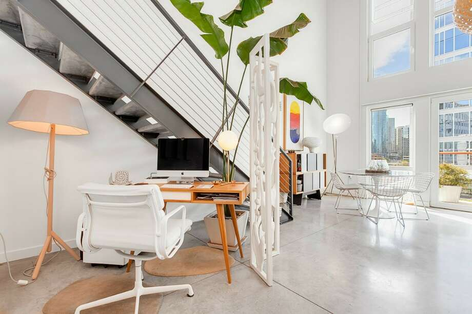 This South Lake Union loft is all set up for tech workers. Photo: Redfin